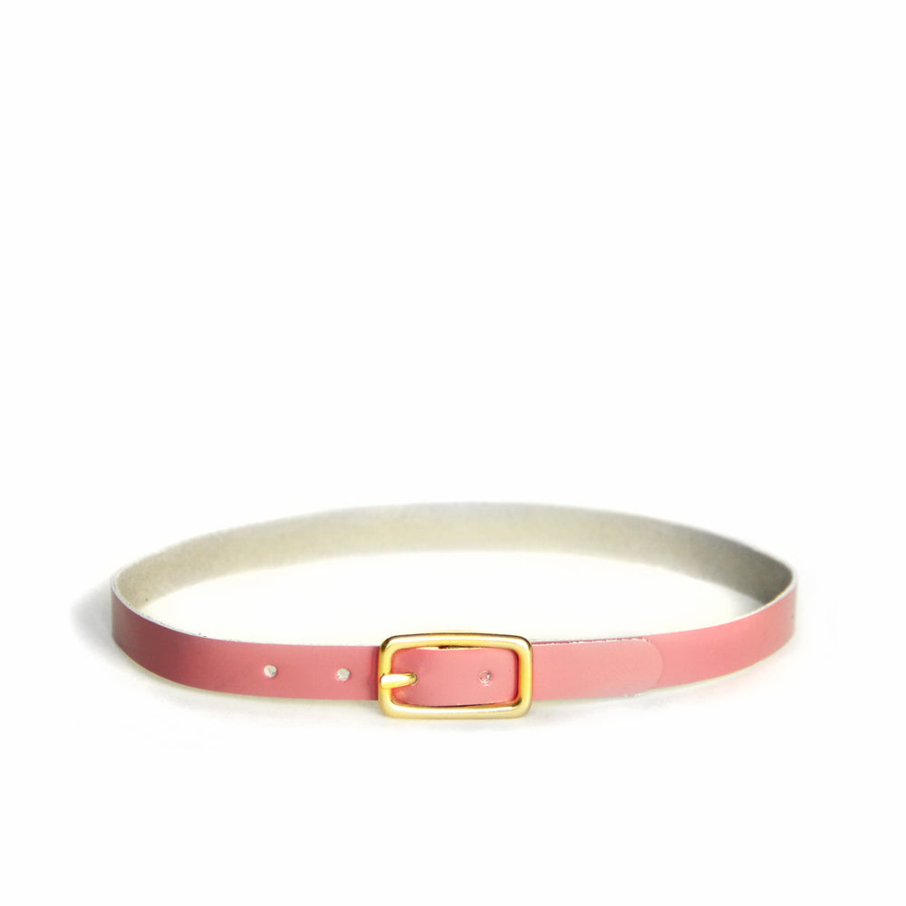Rose pink leather choker with brass hardware, front view