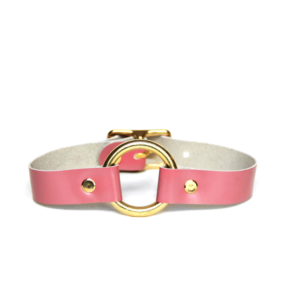 Rose pink leather choker with brass O-ring and hardware, front view