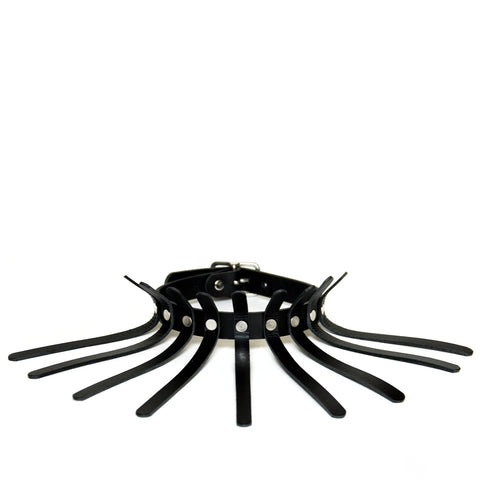 Black leather choker with nine thin spines coming off of the main choker base