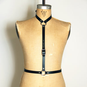 Front view of black leather Artifice body harness
