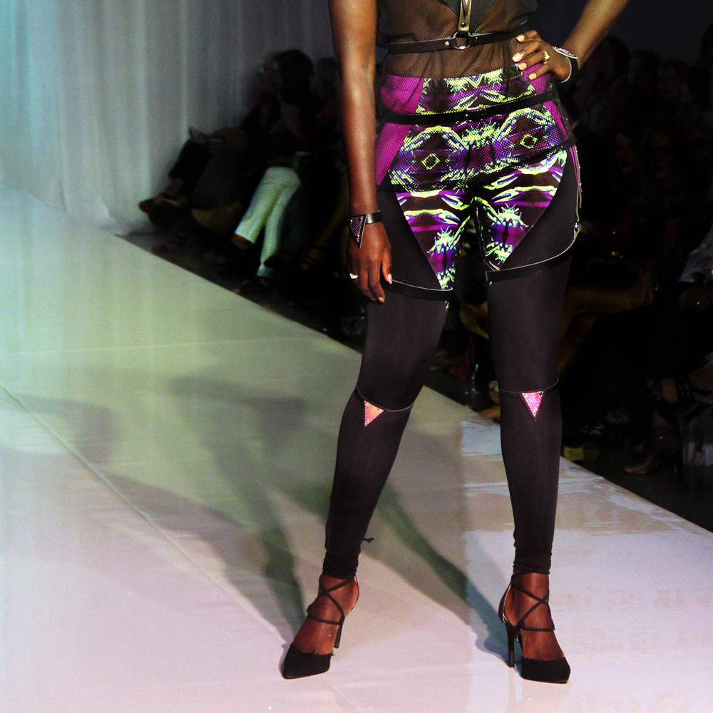 Model wearing Trianthem Knee triangles harnesses