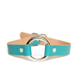 O-ring collar made from teal leather and silver hardware. Backside of leather is tan.