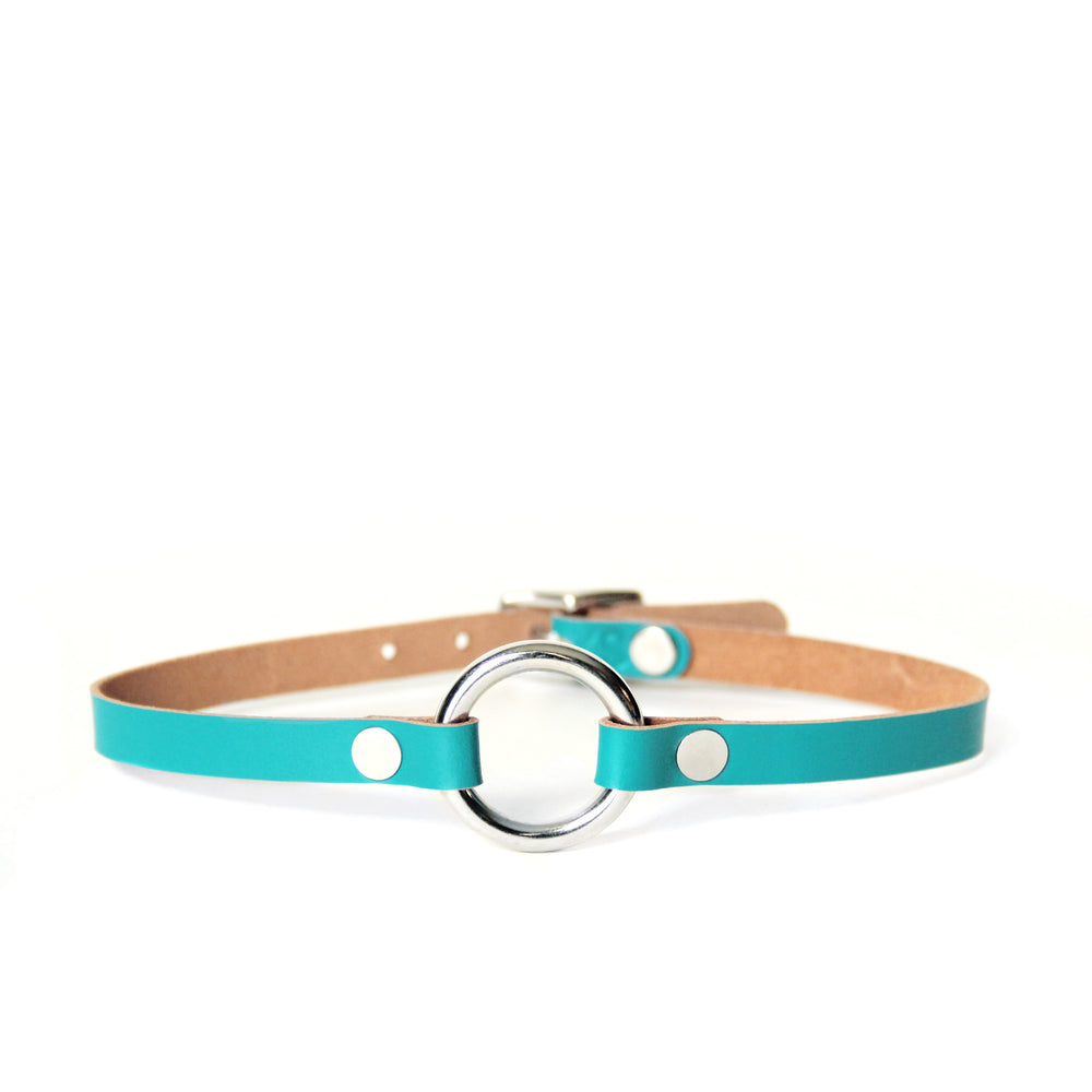 Teal leather choker with a silver o-ring shown on a white background. Back of leather is tan.