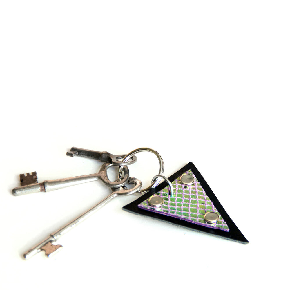 Trianthem keychain, mermaid triangle leather shown with skeleton keys and angled to show color change