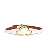 Thin, white choker with brass o-ring and hardware shown on a white background.