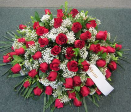 red rose casket spray funeral flower delivery