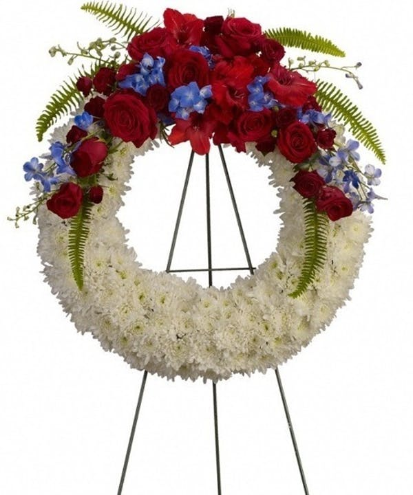 red roses wreath white blue delivery