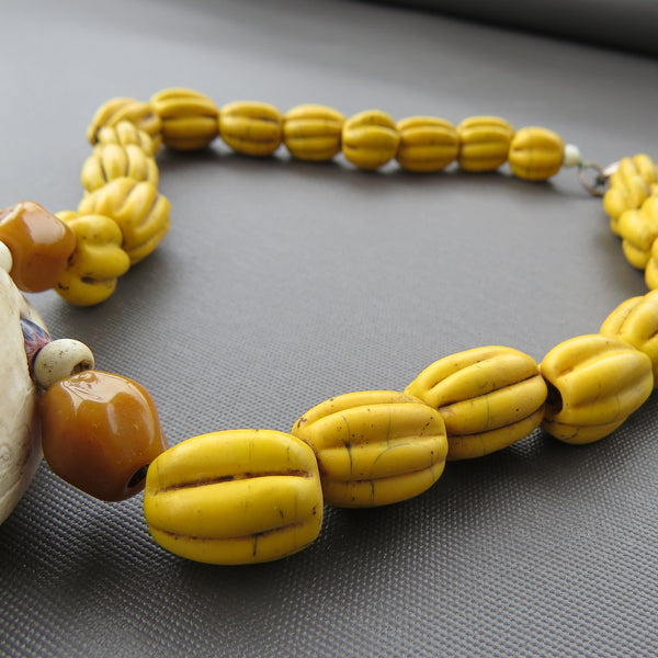 Egg Cowrie and yellow melon beads