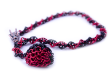 Load image into Gallery viewer, D20 captured necklace with dragon head clasp