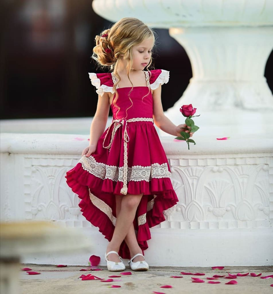 a girl in a pink dress