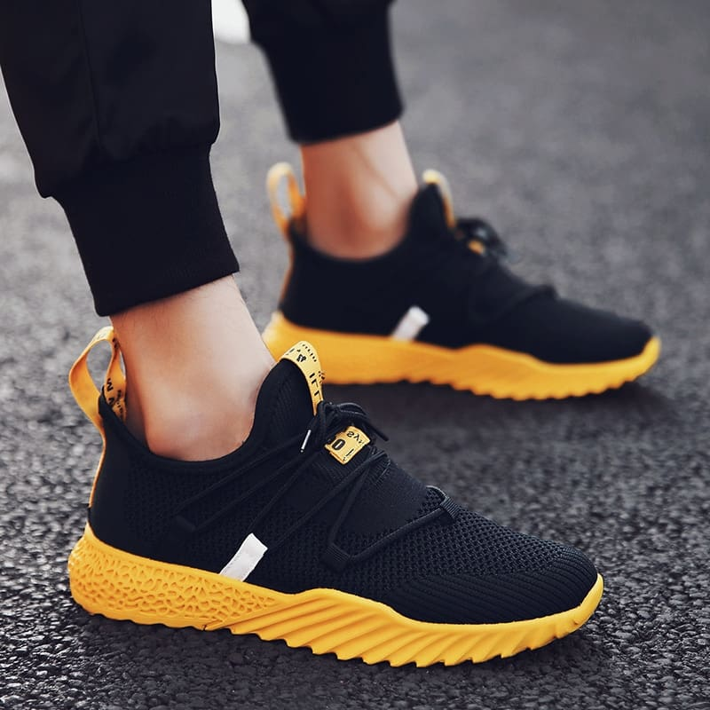 a yellow and black shoes
