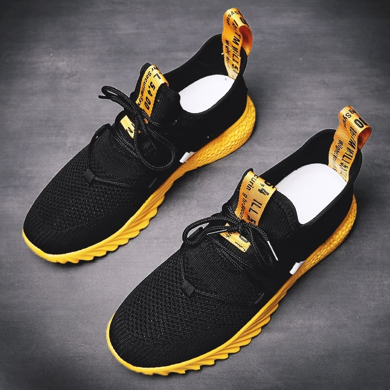 a black and yellow sneakers