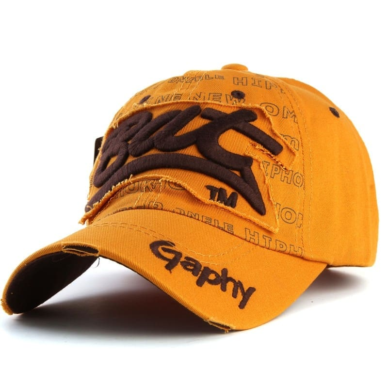 a yellow and black baseball hat