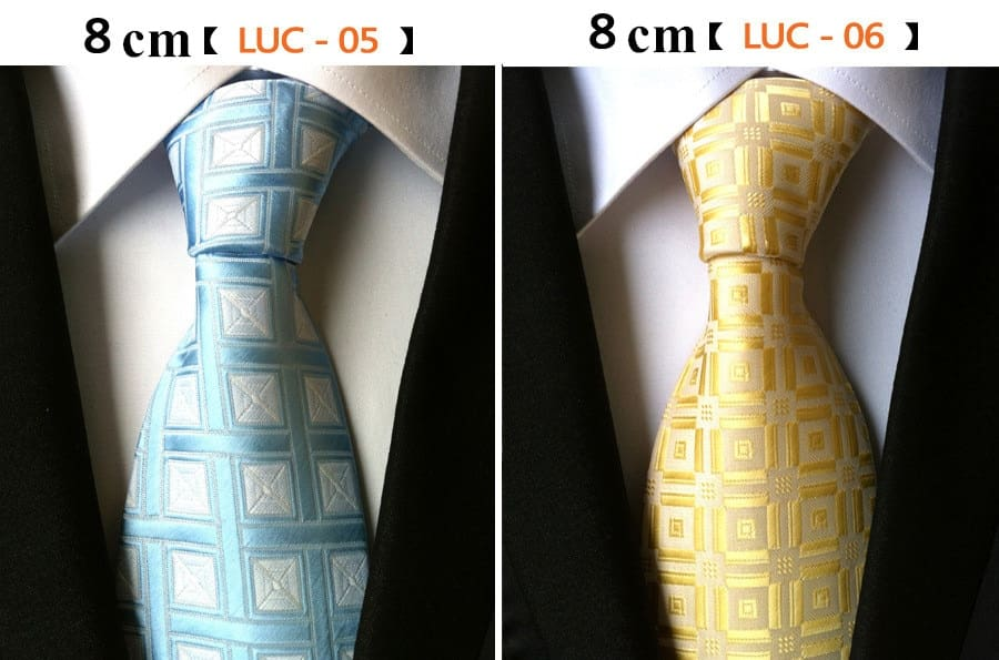 a group of different colored ties