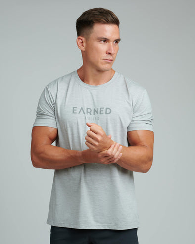 EARNED PERFORMANCE TEE (GREY LOGO)