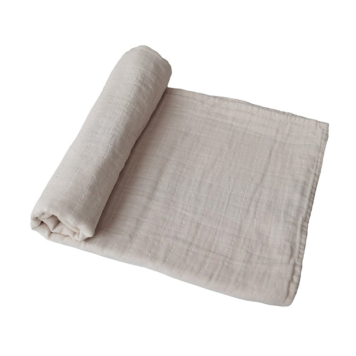 mushie organic muslin swaddle blanket for baby in fog