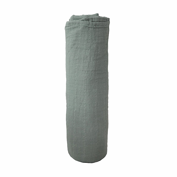 mushie organic cotton muslin swaddle blanket for baby in roman green