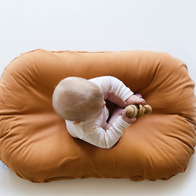 snuggle me organic ember orange baby lounger