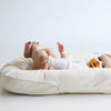 baby sleeping on organic cotton bed lounger