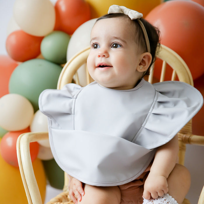 Snuggle Bib Waterproof in Dove Frill