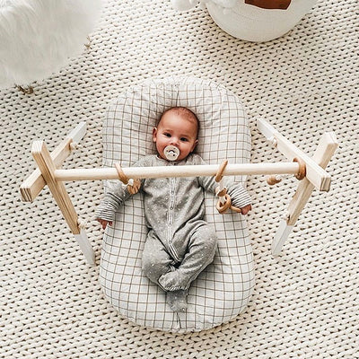 wooden baby gym baby in lounger