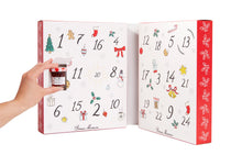 Load image into Gallery viewer, 2019 Bonne Maman® Advent Calendar inside view with hand holding 1 ounce jar