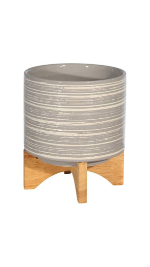 Grey and White Ribbed Planter on Wood Stand