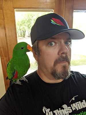 Tiki Checking out the Hat Prototype