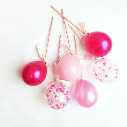 Pretty pink balloon pops