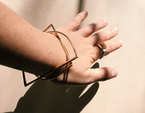 BRASS HALF MOON BANGLE - THE UNIVERSE CONSPIRES