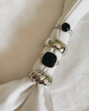 Sterling silver ring with black onyx gemstone and engraved pattern