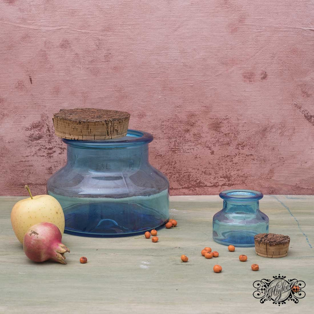 Pair of light blue glass jars with cork