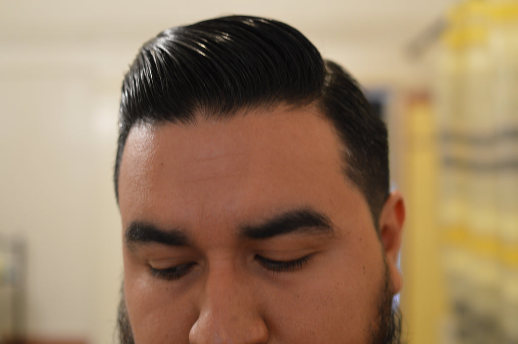 front shot of Miles Coltranes hair styled with Manshine Pomade