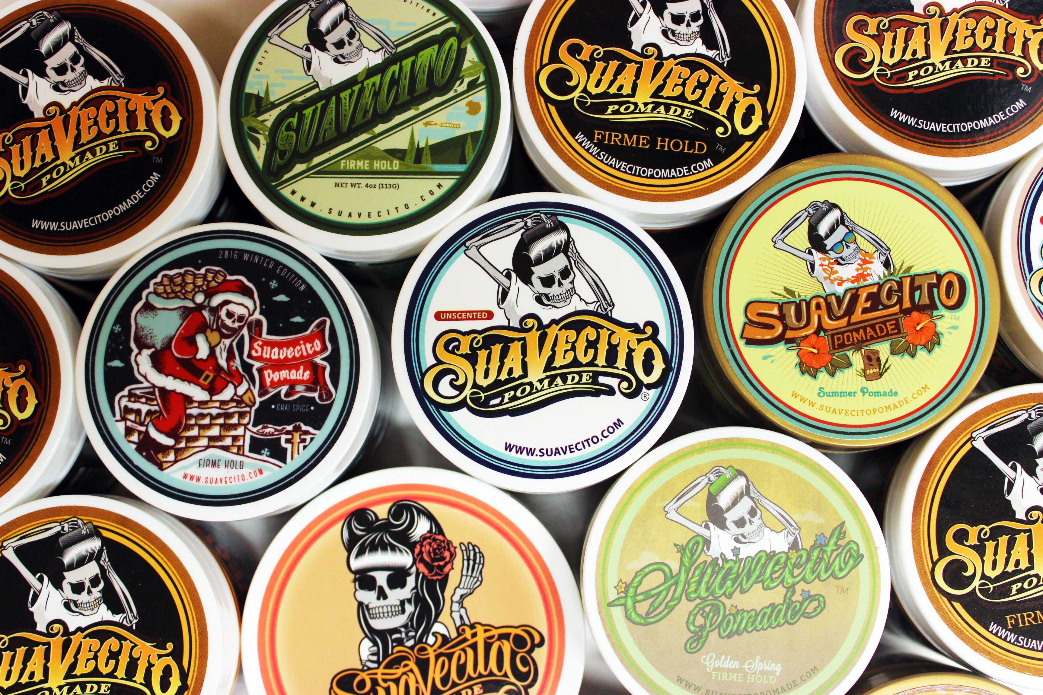 Various edition cans of suavecito pomade