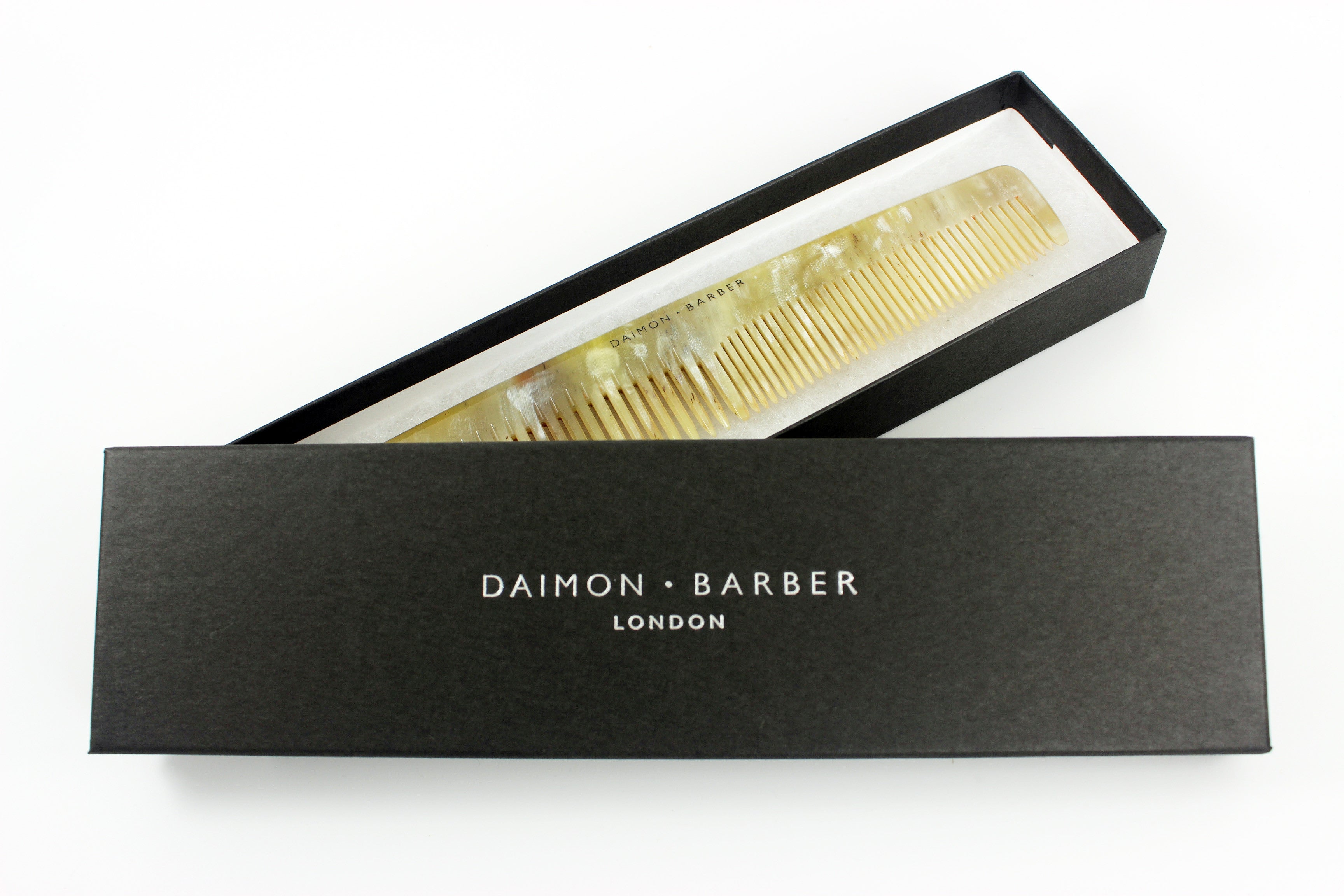 https://www.pomade.com/products/the-daimon-barber-horn-comb