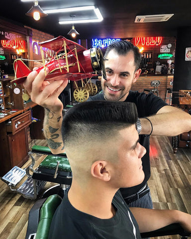 Barber with airplane