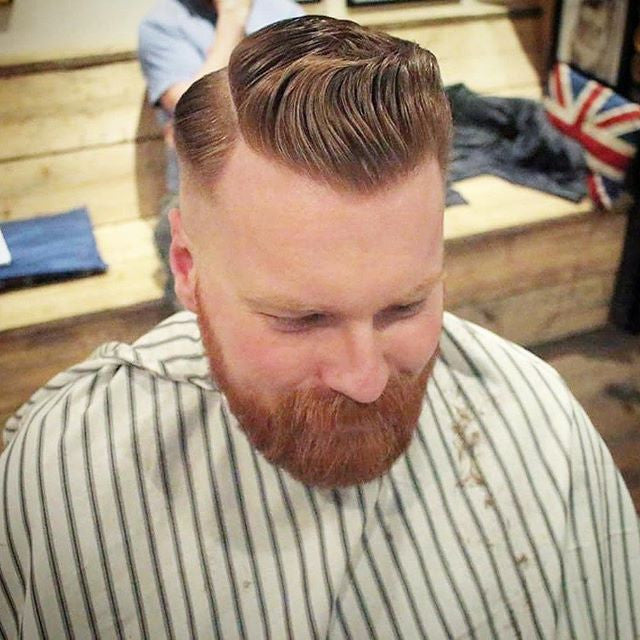 Blackmoth Barbers gentleman with a side part.