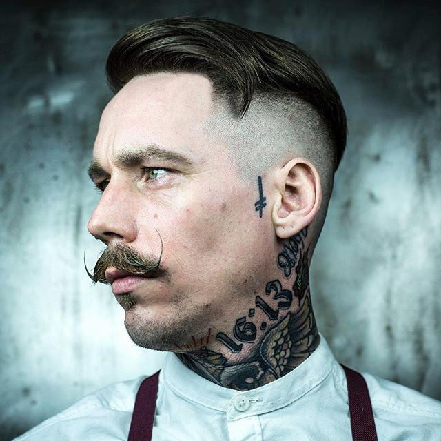 Side part undercut looking good paired with a handlebarmustache