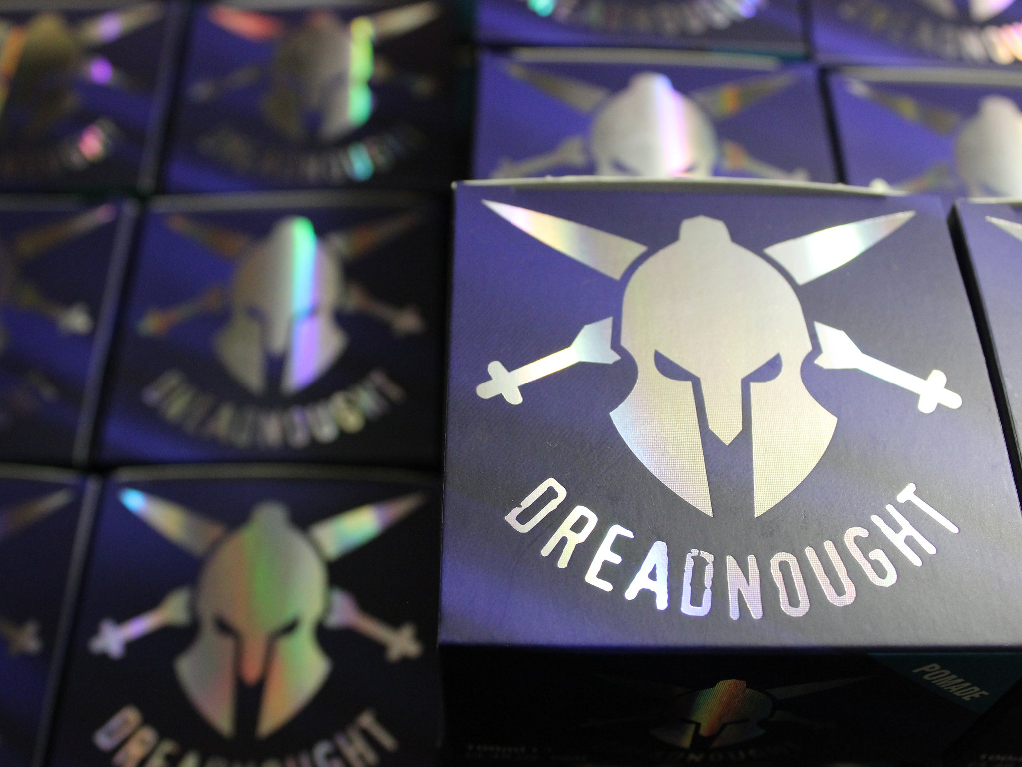 Photo of the Dreadnought Pomade with Matt Clay and Matt Paste in the background