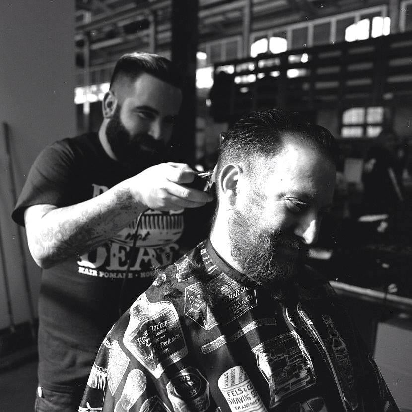 Zachary of Shear Revival cutting hair