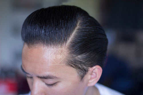 Suavecito Firme Hold Pomade - pomp side view