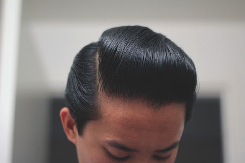 Hair Styled With Black and White Hair Dressing Pomade - Side View