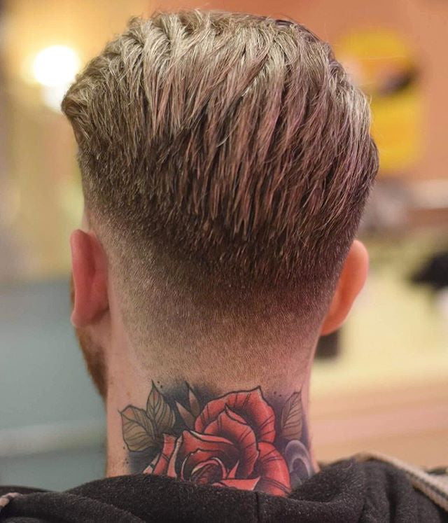 Fresh haircut on a man with a back neck tattoo