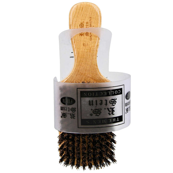 soft bristle side and a firmer bristle side brush