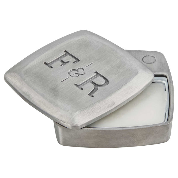 open metal container of solid cologne from fulton & roark
