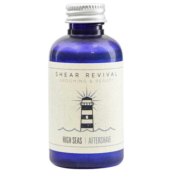 Beautiful blue bottle of high seas aftershave by shear revival