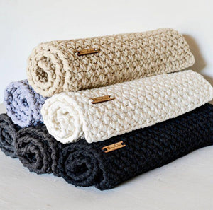Bathmats handmade from recycled spaghetti yarn.