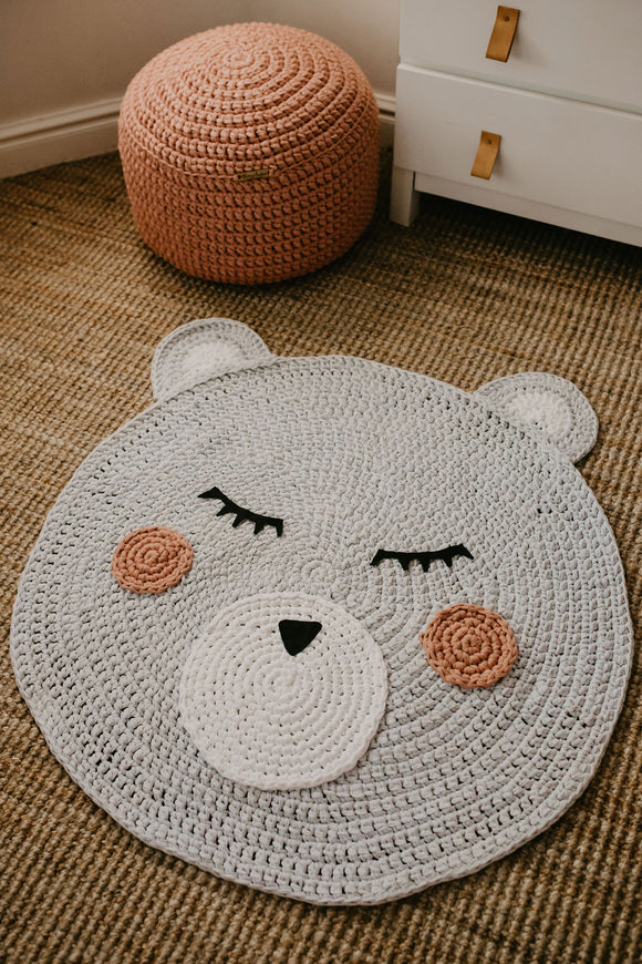 Grey Bear Face rug are handmade from recycled yarn.