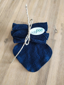 Odd Pod Reusable Baby Wipes in blue and white cotton towelling, rolled up in pack of eight.