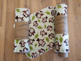 Odd Pod Kitchen Unpaper towel made from 100% cotton flannel, in a minty green colour with owls and leaves on it.